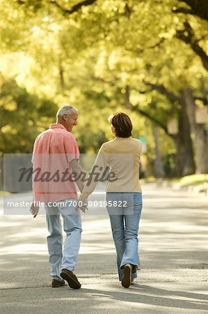 Couple Walking down Country Road Stock Photo - Rights-Managed, Image code: 700-00195822