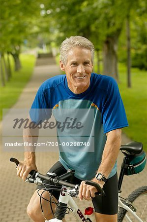 Man Riding Bike Stock Photo - Rights-Managed, Image code: 700-00268740