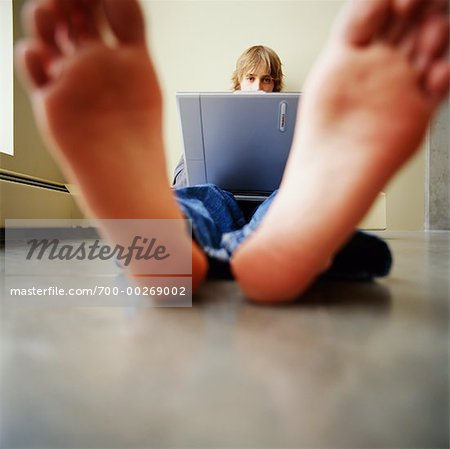Teen Using Laptop Stock Photo - Rights-Managed, Image code: 700-00269002