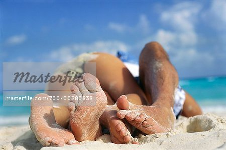 Couple Lying on Beach Stock Photo - Rights-Managed, Image code: 700-00280838