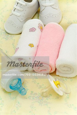 Baby Bottle, Pacifier, Washcloths And Baby Shoes Stock Photo - Rights-Managed, Image code: 700-00281817