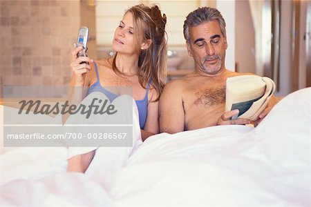 Couple in Bed Stock Photo - Rights-Managed, Image code: 700-00286567