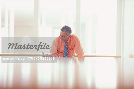 Businessman Using Cellular Phone Stock Photo - Rights-Managed, Image code: 700-00286569