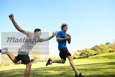 Young Men Playing Football Stock Photo - Rights-Managed, Image code: 700-00328529