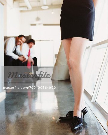 Men Staring at Woman's Legs in Office