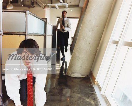 Man Sneaking out of Office Stock Photo - Rights-Managed, Image code: 700-00364003
