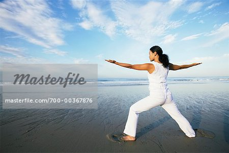 Woman Doing Yoga on Beach Stock Photo - Rights-Managed, Image code: 700-00367876