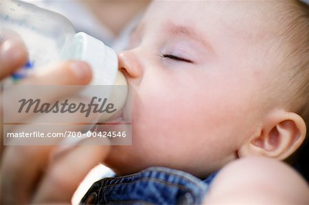 Parent Feeding Baby Stock Photo - Rights-Managed, Image code: 700-00424546