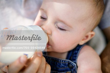 Parent Feeding Baby Stock Photo - Rights-Managed, Image code: 700-00424548