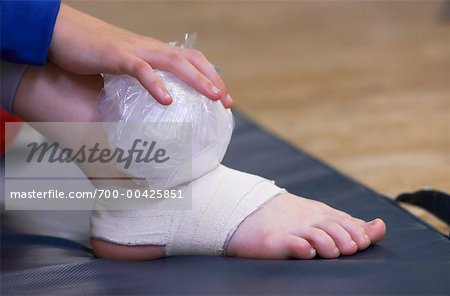 Dancer Holding Ice Pack on Foot Stock Photo - Rights-Managed, Image code: 700-00425851