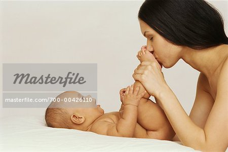 Mother Kissing Baby's Feet Stock Photo - Rights-Managed, Image code: 700-00426110