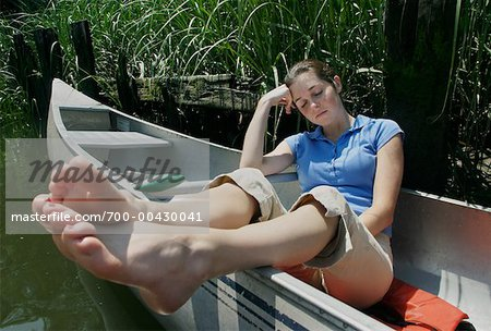 Girl Sleeping in Canoe Stock Photo - Rights-Managed, Image code: 700-00430041