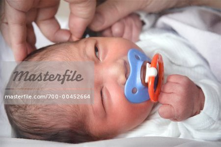 Hands Examining Ear of Newborn Stock Photo - Rights-Managed, Image code: 700-00452664