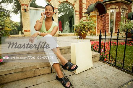 Woman Using Cellular Phone Stock Photo - Rights-Managed, Image code: 700-00477623