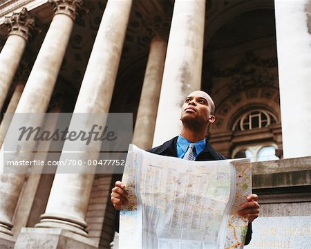 Businessman Holding a Map Stock Photo - Rights-Managed, Image code: 700-00477752