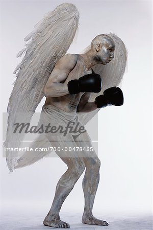 Man Posing as Angel Stock Photo - Rights-Managed, Image code: 700-00478465