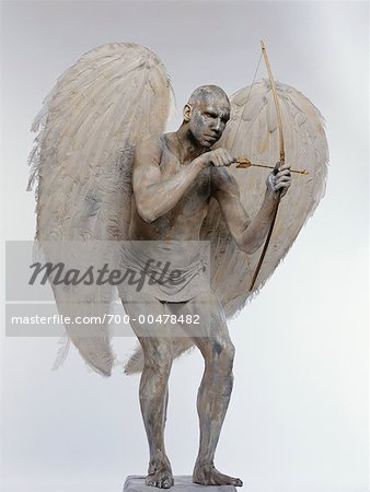 Man Posing as Angel with Bow and Arrow Stock Photo - Rights-Managed, Image code: 700-00478482