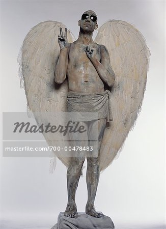 Man Posing as Angel Stock Photo - Rights-Managed, Image code: 700-00478483