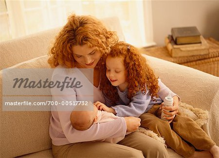 Mother Feeding Baby with Daughter Stock Photo - Rights-Managed, Image code: 700-00517732