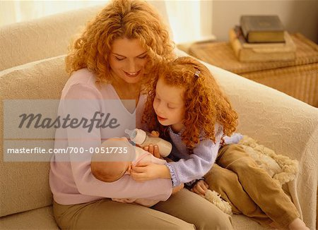 Mother Feeding Baby with Daughter Stock Photo - Rights-Managed, Image code: 700-00517735