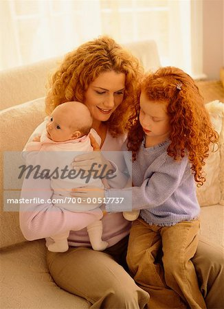 Mother Burping Baby with Daughter Stock Photo - Rights-Managed, Image code: 700-00517737