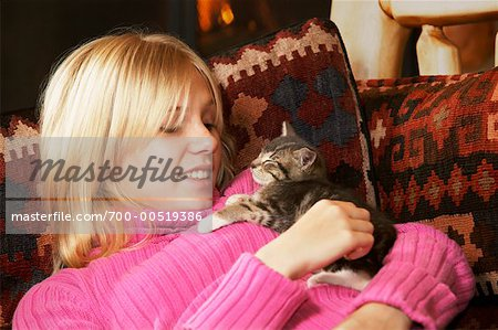 Girl Holding Kitten Stock Photo - Rights-Managed, Image code: 700-00519386