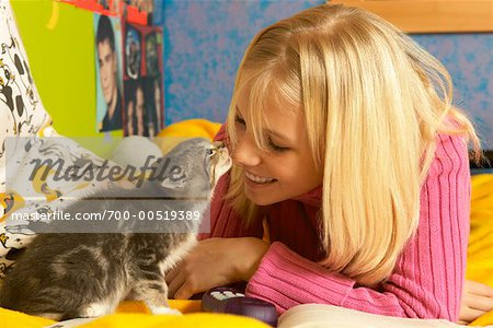 Girl Playing with Kitten Stock Photo - Rights-Managed, Image code: 700-00519389