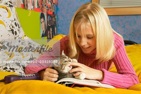 Girl Playing with Kitten Stock Photo - Rights-Managed, Image code: 700-00519390