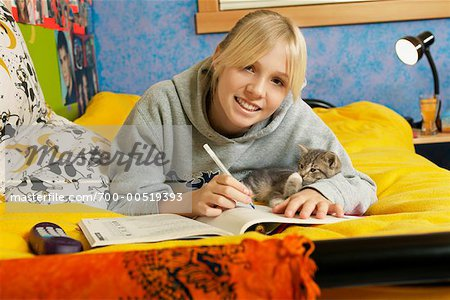 Girl Doing Homework Stock Photo - Rights-Managed, Image code: 700-00519393