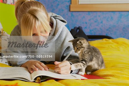 Girl Doing Homework Stock Photo - Rights-Managed, Image code: 700-00519394