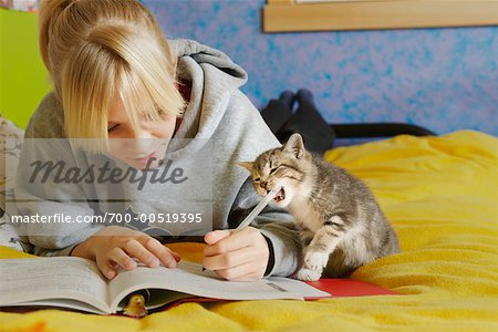 Girl Doing Homework Stock Photo - Rights-Managed, Image code: 700-00519395