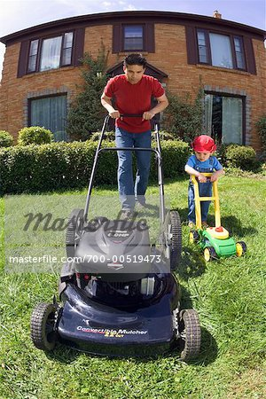 Father and Son Mowing the Lawn Stock Photo - Rights-Managed, Image code: 700-00519473