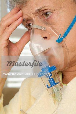 Woman Using Oxygen Mask