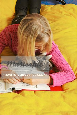 Teenage Girl With Kitten, Doing Homework, British Columbia, Canada Stock Photo - Rights-Managed, Image code: 700-00522278