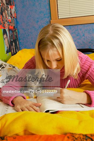 Teenage Girl With Kitten, Doing Homework, British Columbia, Canada Stock Photo - Rights-Managed, Image code: 700-00522279