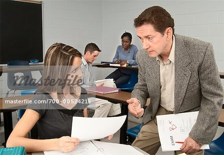 Teacher Talking to Student