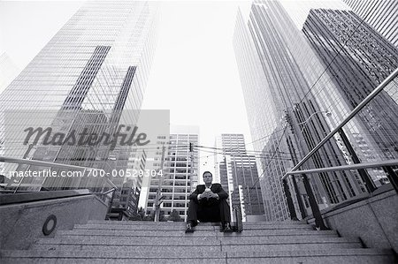 Businessman Sitting on Steps Stock Photo - Rights-Managed, Image code: 700-00529304