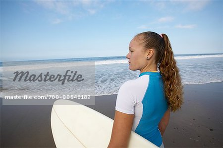Woman on Beach with Surfboard Stock Photo - Rights-Managed, Image code: 700-00546182