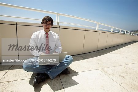Businessman Using Laptop Computer Stock Photo - Rights-Managed, Image code: 700-00546279