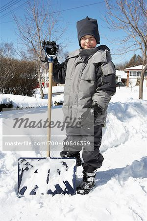 Boy Standing Next to Snow Shovel in Winter Stock Photo - Rights-Managed, Image code: 700-00546359