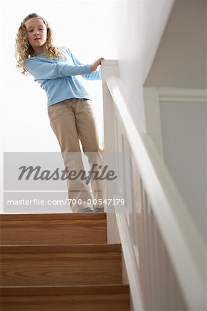 Girl Looking Down Staircase