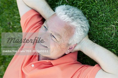 Portrait of Man Lying on Grass Stock Photo - Rights-Managed, Image code: 700-00549551
