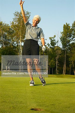 Woman Golfing Stock Photo - Rights-Managed, Image code: 700-00550095