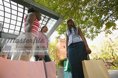 Teenagers with Shopping Bags Stock Photo - Rights-Managed, Image code: 700-00550275