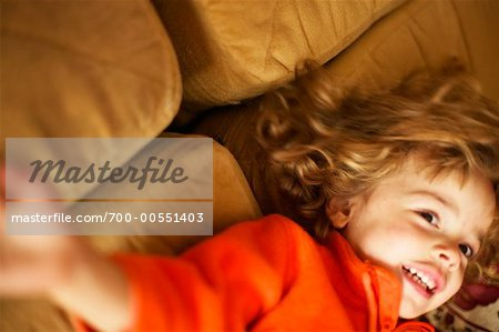 Girl on Sofa Stock Photo - Rights-Managed, Image code: 700-00551403