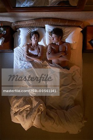 Couple in Bed Stock Photo - Rights-Managed, Image code: 700-00561141