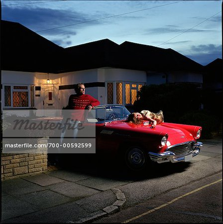 Couple in Driveway with Car Stock Photo - Rights-Managed, Image code: 700-00592599