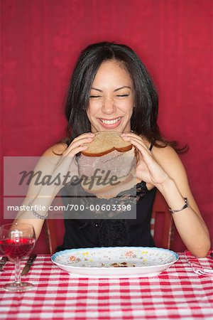 Woman Holding Beef Sandwich Stock Photo - Rights-Managed, Image code: 700-00603398