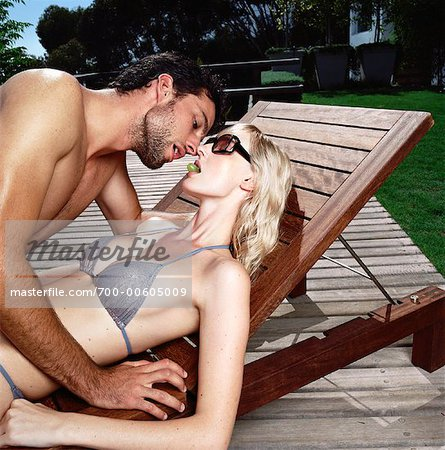 Couple Lying on Deck Chair Stock Photo - Rights-Managed, Image code: 700-00605009