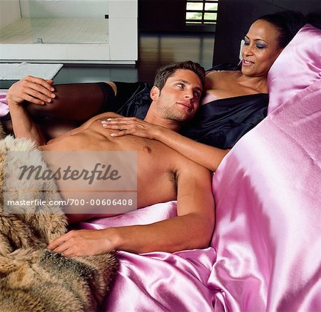 Couple Lounging In Bed Stock Photo - Rights-Managed, Image code: 700-00606408